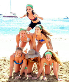The teen babes frolic on the beach,..